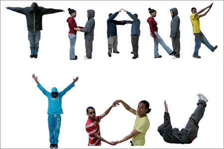 Avenues for Justice's youth spell out their thanks to those who support the cause.