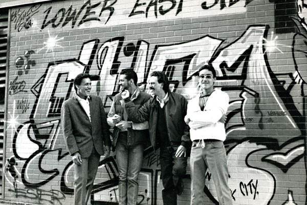 1981: Amid its struggles, the Lower East Side produced talented local heros. Here Angel and a Glover Youth worker introduce two teens to the billboard work of renowned Lower East Side graffiti artist, Chico.