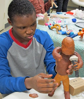 With mic in hand, this clay figure is a rapper in the making.