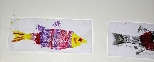 Students learn to use color to create variety with the fish prints.