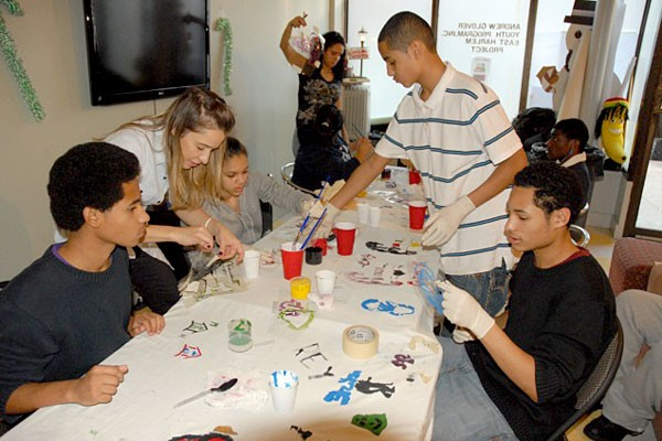 East Harlem students learn how to make fabric and stencil designs from Calvin Klein's Alessandra Berg.